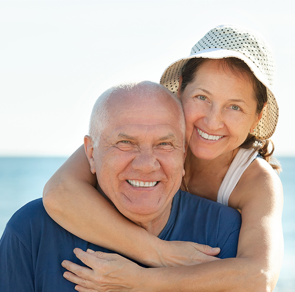 Happy old couple hugging and smiling